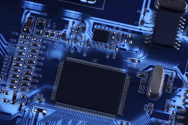Macro photo of electronic circuit. PCB on the lighting.