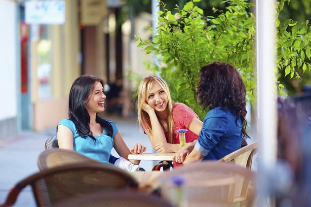 """happy friends talking in summer cafe, urban outdoors"""
