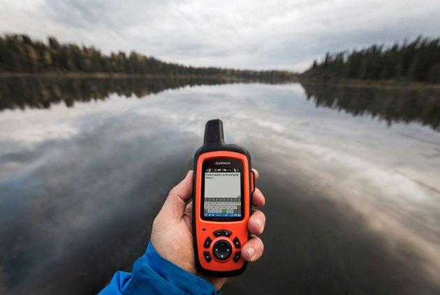Photo of Garmin's inReach global satellite communicator handheld being used while on a river.