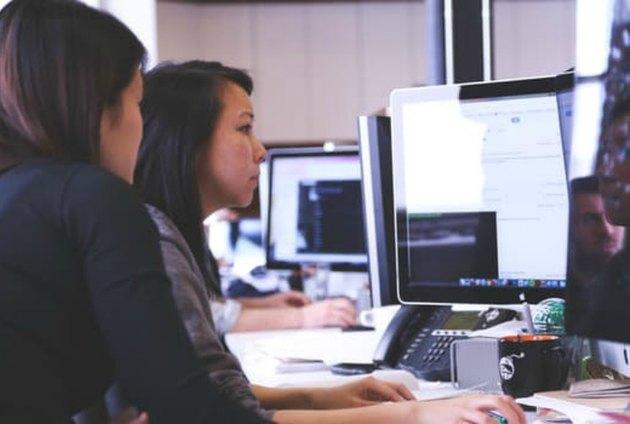 Teen girls practice computer coding