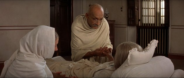 Still of Gandhi clutching Katsurba Gandhi's hands.