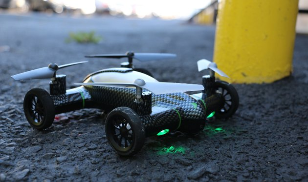 Photo of the Fly and Drive Quadcopter resting on the ground.