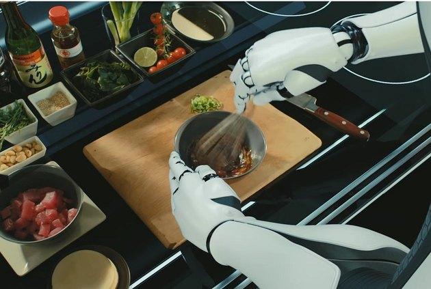 robot arms prepare a meal