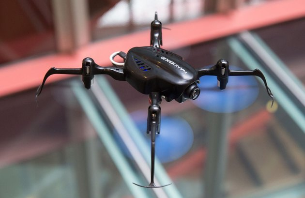 Photo of a Blade Nano QX2 first-person video drone flying.