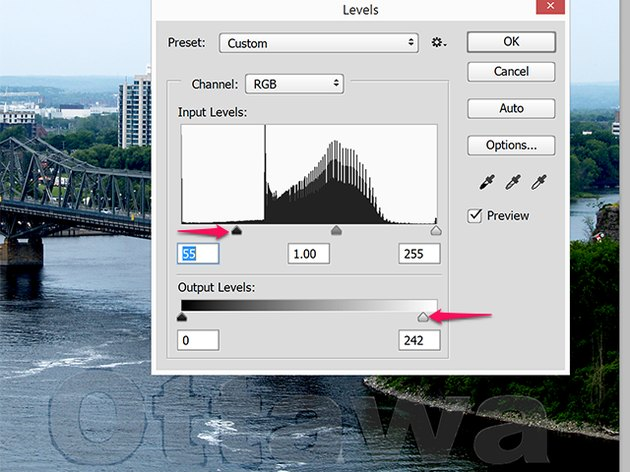 A slight adjustment to the Input and Output levels fades this watermark significantly.