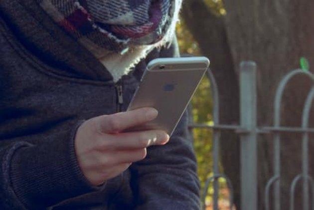 Kid looking at smartphone