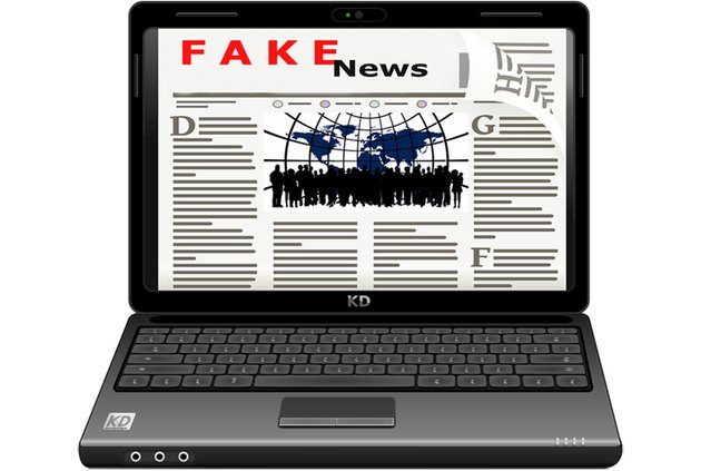 Laptop with fake news headline