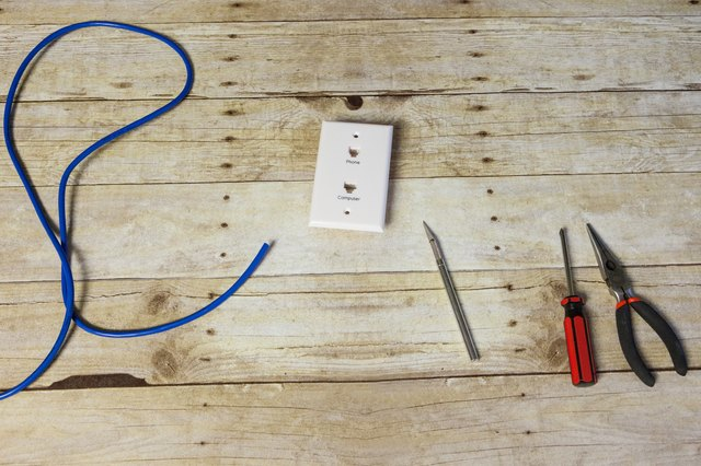 Use a knife or stripper tool to gently cut the outer cable\u0027s casing and strip the phone cable about 2 inches from the end. Strip each of the four smaller ... & How to Wire a DSL Jack | Techwalla.com